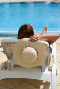woman relaxes by the pool