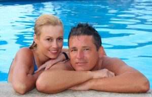 happy-couple-in-swimming-pool-300x191